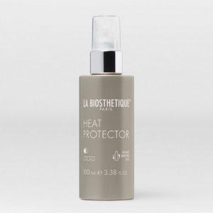 Le spray Heat Protector protège efficacement les cheveux de la chaleur et leur apporte douceur, souplesse et brillance. Tenue 1/3